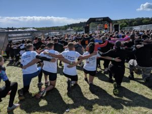 Image of team members at beginning of Tough Mudder fundraiser