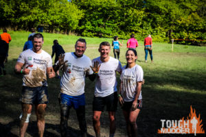 Image of team members after completing their Tough Mudder fundraiser
